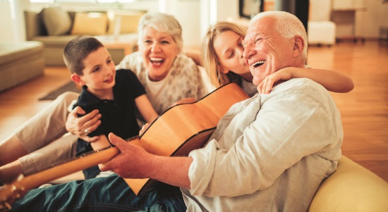 Close up of a grandfather and grandmother having a great time with grandchildren